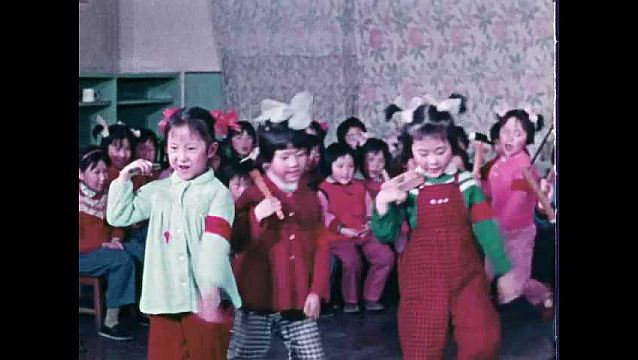 1960s: Children in classroom, dance, sing song, hold tools.