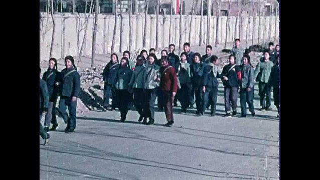 1960s: Students walk through gates.