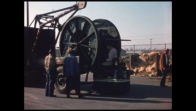 1950s: forklift picks up empty spool and drives it away to other empty spools