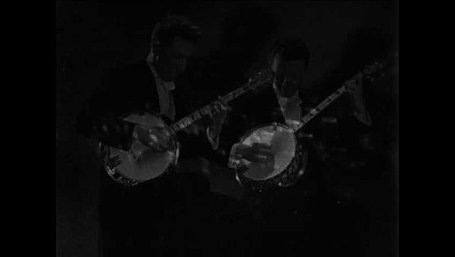 1950s: UNITED STATES: men play banjos. Sound creates waves on device