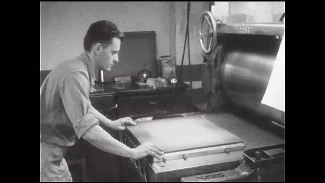 1950s: Man pushes plate into press. Man pulls plate from press. Man with plate, rolls back press. Man trims paper.