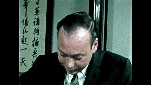 1960s: Man eats tempura. Man and woman talk and eat tempura.