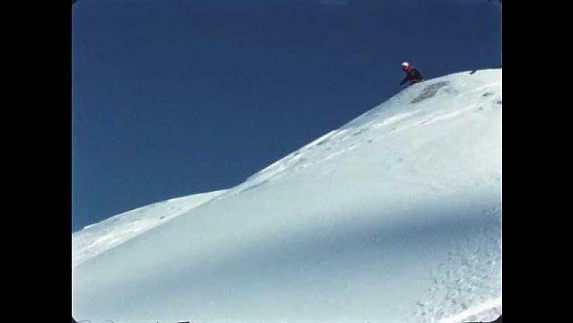 1950s: UNITED STATES: man skis down mountain slope