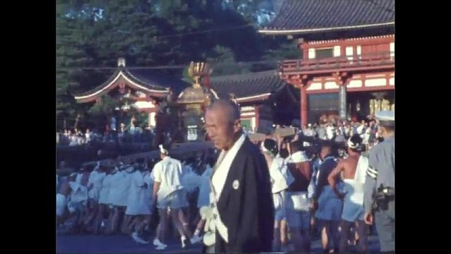 1960s JAPAN: Men in robes carry float in parade near temple. Men in traditional armor march in parade. Man in military costume rides horse in parade.