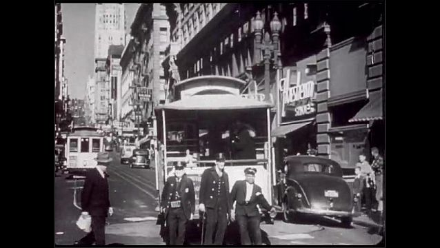 1940s: San Francisco, city street, men pull cable car around on turntable at end of line. Union Square, cars enter underground parking garage.