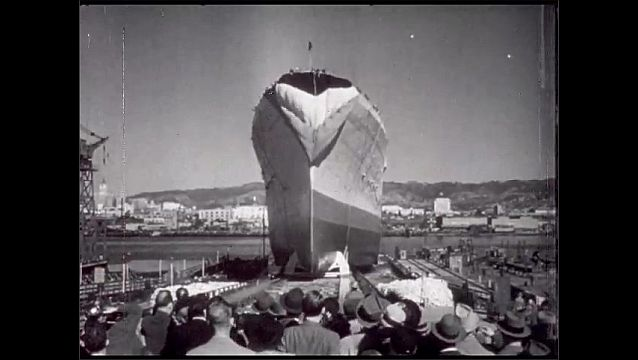 1940s: San Francisco, port, Hunters Point Naval Shipyard, crowd watches new ship being launched.