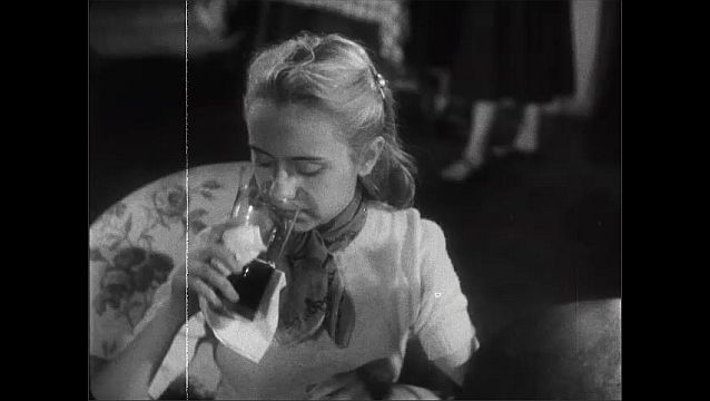 1940s: Messy blonde girl feels badly about her appearance at a party. Other girl asks her a question but she hasn't been listening and doesn't have an answer.