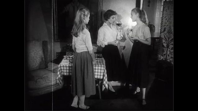 1940s: Messy blonde girl approaches two girls talking and listens awkwardly but does not join the coversation.