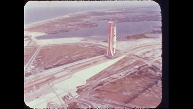 1960s: Rocket on launch pad.  Roads.  Parked cars.  Water.