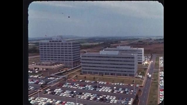 1960s: Buildings.  Mountains.  Parking lot.