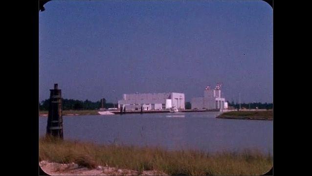 1960s: Water.  Buildings.  Boat.