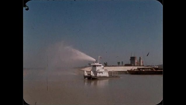 1960s: Tugboat sprays water.