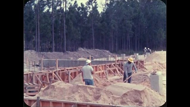 1960s: View of building under construction.