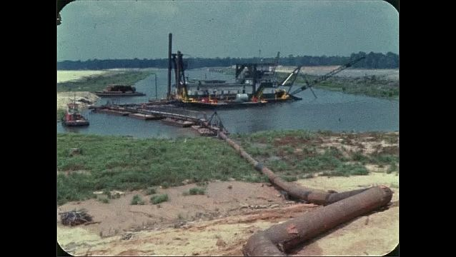 1960s: View of pipeline and machinery in water offshore.