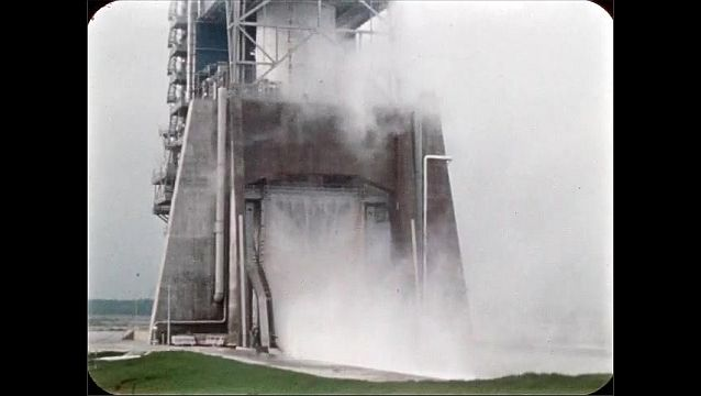 1960s: UNITED STATES: water sprays from door onto fire.