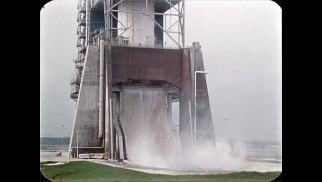 1960s: UNITED STATES: sprinkler system inside concrete tower douses smoke and fire.