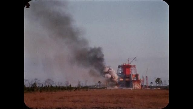 1960s: UNITED STATES: controlled fire testing at NASA test facility. Flames and smoke from fire.