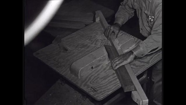 1950s: UNITED STATES: man lays out wood for sawing. Man cuts wood on machine.