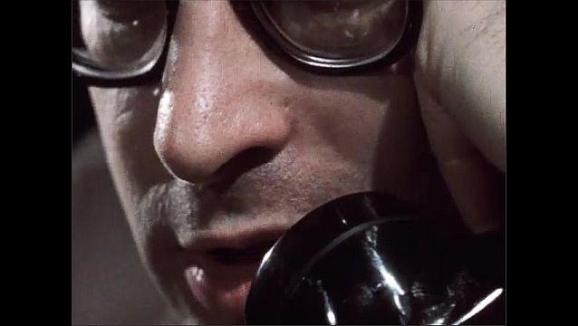 1950s: Telephone. Men yell. Man picks up phone, talks on phone. Man hangs up phone.