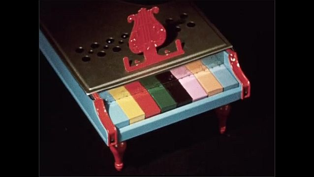 1950s: Baby doll. Keys on toy piano move. Top spins. Jack in the box pops up.
