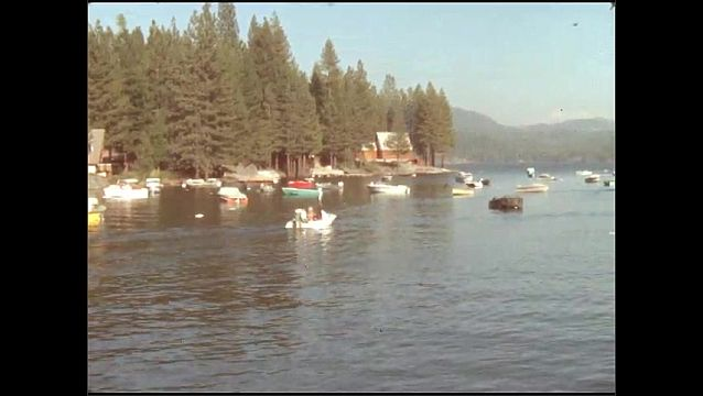 1950s: UNITED STATES: boats on lake. View across lake.