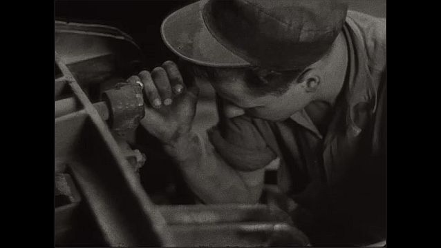 1940s: Hands rotate machinery, tilt down, man removes mold from machine.
