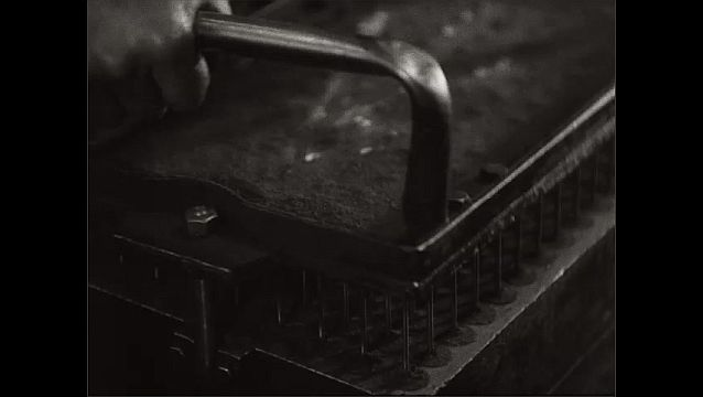 1940s: Close up, hands pounding sand into molds, punching holes in sand, flipping over mold.