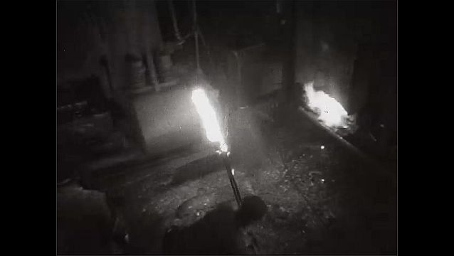 1940s: UNITED STATES: man works with furnace. Steel in furnace.
