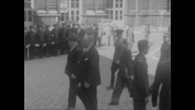 1940s: Car enters front of Luxemburg Palace. Flags fly outside palace. People in crowd, cars parked in lot. Vyacheslav Molotov walks up to palace with several men. James Byrnes walks up to palace.