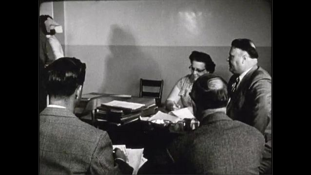 1940s: UNITED STATES: patient sits in meeting with staff. Patient receives diagnosis. Patient transfer to treatment ward for therapy.