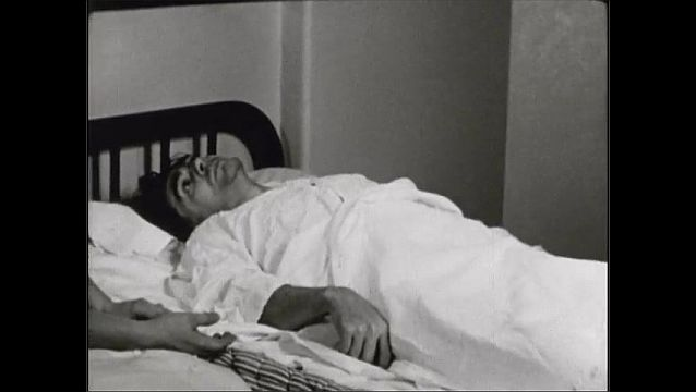 1940s: UNITED STATES: patent receives insulin for schizophrenia. Patient lies in bed. Nurse attends to patient