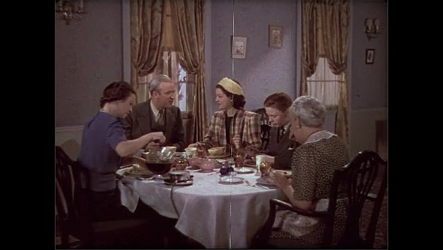 1930s: Dining room, breakfast, family eats, talks. Daughter talks, looks pleased, raises eyebrows, nods, stands with coffee cup. Father talks.
