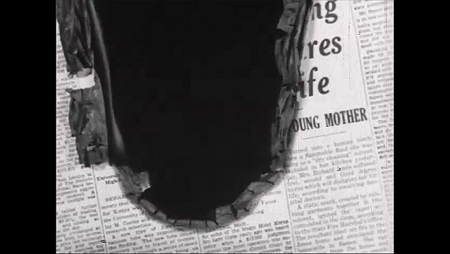 1940s: Close up of newspaper headline, paper burns away, fade out. End credit.