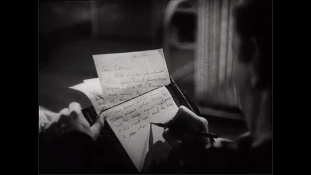 1940s: Soldier on ground, takes cover. Explosive falls, explodes. Dissolve, man writing, zoom in on letter. Soldier with gun walks toward camera.