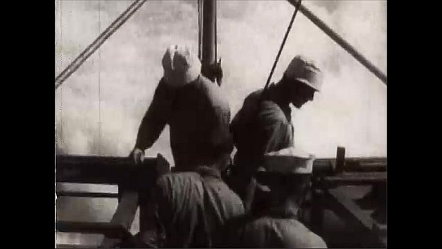 1940s: Battleship on water. Pan across ship. View of ship.