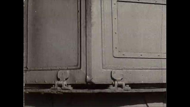 1940s: Men running on ship. Men run to gun, Low angle, men running. Men run up ladder. Doors open. Man looking through viewer. Man at gun. Hand turns knob. Man at viewer. Ships on water.