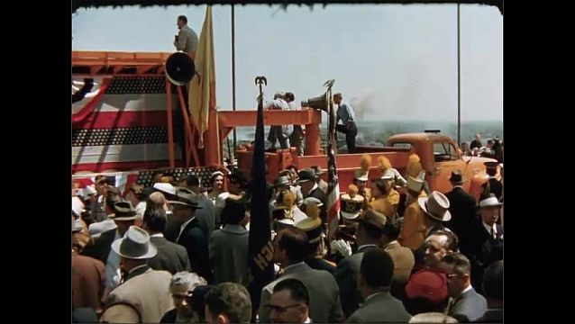 1950s: Crowd gathers in front of mobile stage.