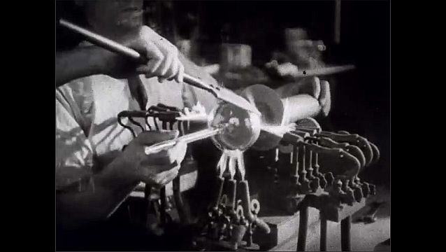 1940s: Workers grind and melt metal alloys in a factory. Kaleidoscope of radio tubes.