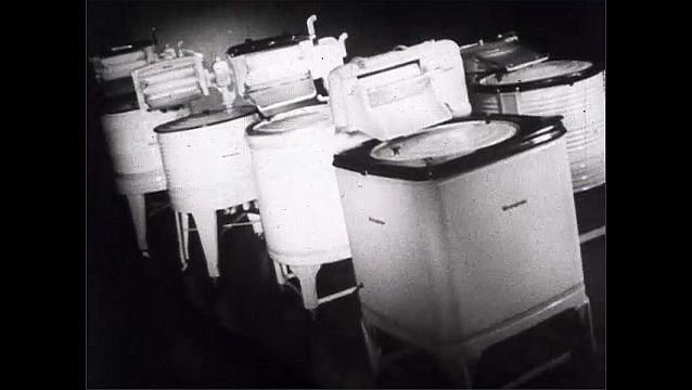 1940s: Animation of butler appears in front of the kitchen. Westinghouse electric washing machines and home appliances.