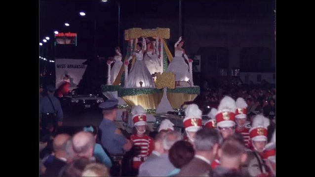 1960s: Miss Arizona waves from convertible. Marching band in parade. Women wave from parade float.