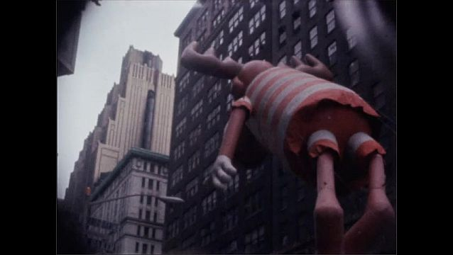 1960s: NEW YORK, UNITED STATES: inflatable reindeer flies in New York street parade.
