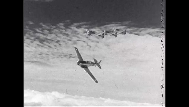 1940s: Cloudy sky, army propeller planes fly in formation, peel off, turn, fly sideways.