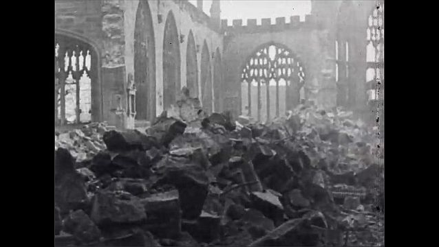 1940s: England, bombed out building, people pass along busy street. Piles of rubble in front of church. Winston Churchill shakes hands with men in helmets, military uniforms.