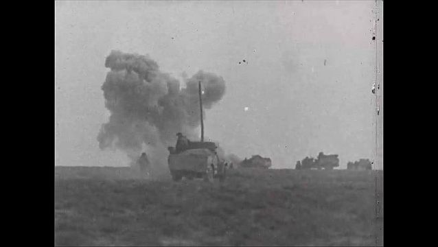 1940s: Sea. Soldiers in field fire large guns. Explosions, smoke billows. Battleships fire guns. Soldiers in helmets hold guns, crouch in trench. Artillery, equipment stores.