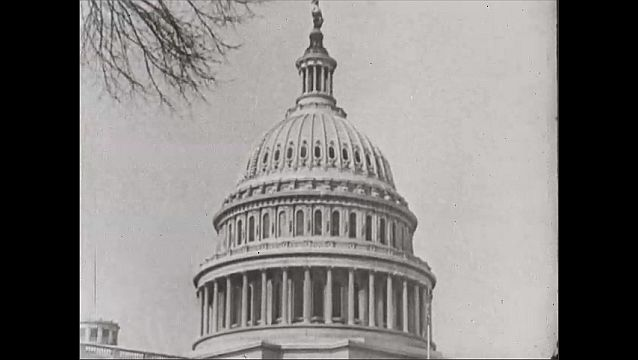 1940s: United States Capitol Building, Washington, D.C. Leafless trees in winter, dome. St. Paul, Minnesota, annual ice festival, street parade, people in uniforms march.