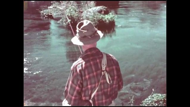 1950s: View of river, man walks past camera. Man by river, man takes lure from hat.