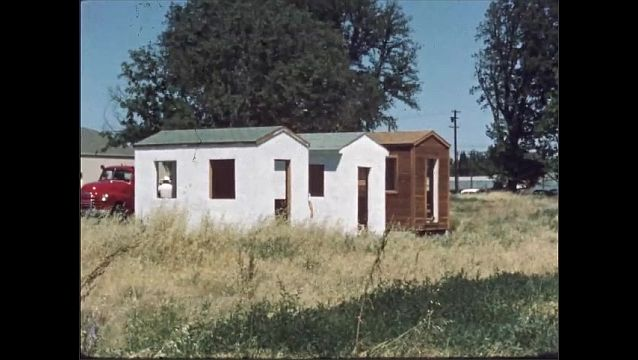 1960s: UNITED STATES: shed with concrete floor. Clean floor. Floor covered with paint. Man looks at shed. Emergency services look at shed.