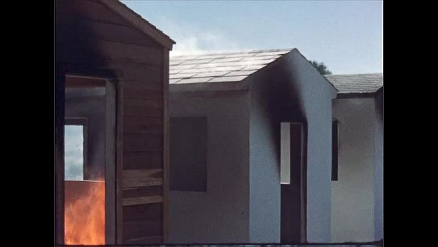 1960s: UNITED STATES: roof of shed burns. Painted sheds with minimal fire damage.