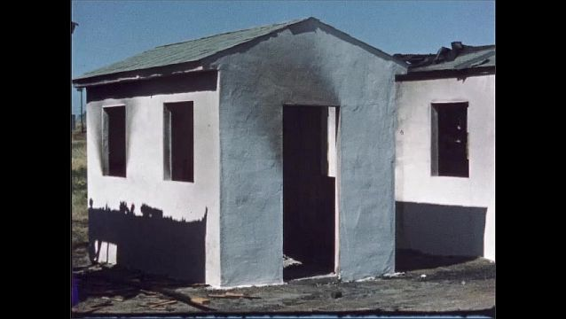 1960s: UNITED STATES: interior fire damage of shed. Chicken wire in shed. Shed door and windows.