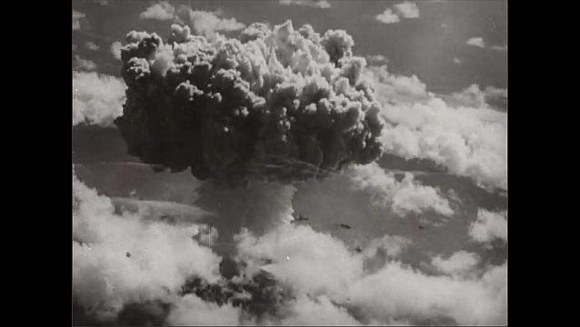 1940s: Large explosion, mushroom cloud. People sit around table.